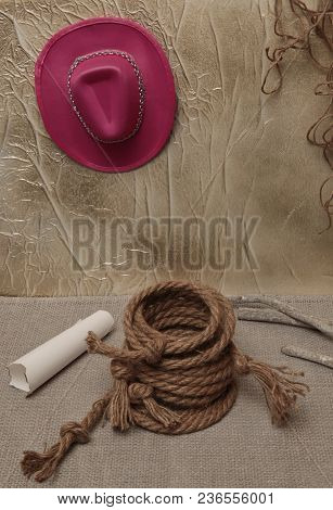 Cowboy Hat Old Folded Rope White Paper Bundle On A Light Background