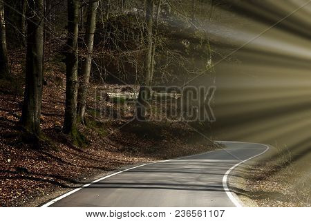 Mystery Tour. A Winding Road Leading Rocky Valley. Backlight Sunlight.