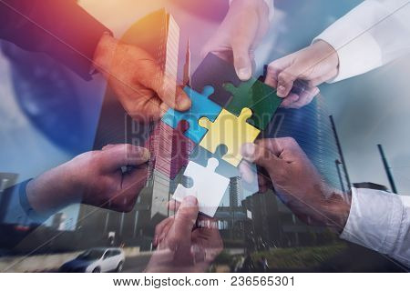 Businessmen Working Together To Build A Colored Puzzle. Concept Of Teamwork, Partnership, Integratio