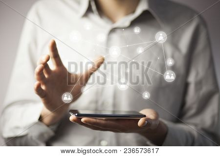 Businessman Hand Phone With Virtual Social Media Buttons