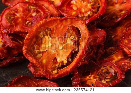 Sundried Tomatoes Close Up On Rustic Background