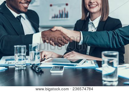 Make A Deal. Multiethnic Business Meeting. Handshake. Business Meeting. Encounter In Boardroom
