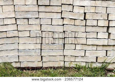 Stacked Old Weathered Concrete Bricks For Pavement. Stacked Footpath Brick Texture Background