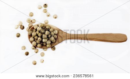 White Peppercorn In Wooden Spoon Isolated On White Background
