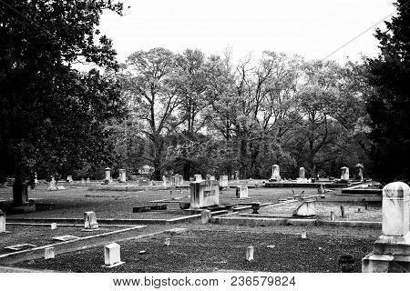 Small Town Cemetery With Old Graves In Black And White.
