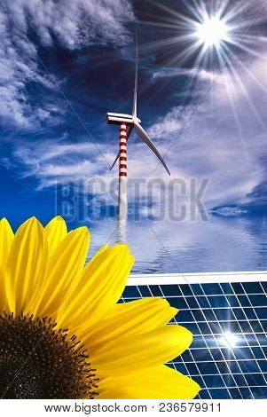 Summer Landscape With Sunflower And Solar Panel In The Foreground And Wind Turbines In The Backgroun