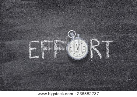 Effort Word Handwritten On Chalkboard With Vintage Precise Stopwatch Used Instead Of O