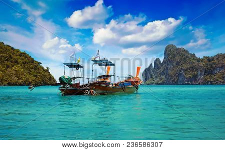 Traditional Thai Longtail Boats In Loh Dalam Bay Under A Blue Sky With Clouds, Phi Phi Island, Thail