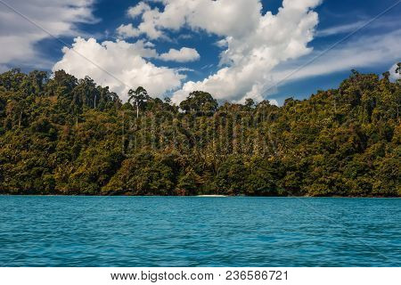 Ko Chuek Island, With Palm Trees And Turquoise Water Under A Blue Sky With Clouds. Ko Lanta, Thailan