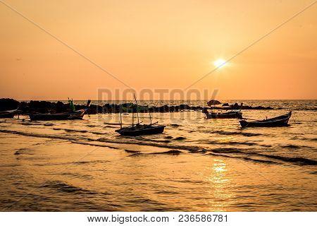 Traditional Thai Long Tail Boats At Sunset, Long Beach, Ko Lanta, Thailand.