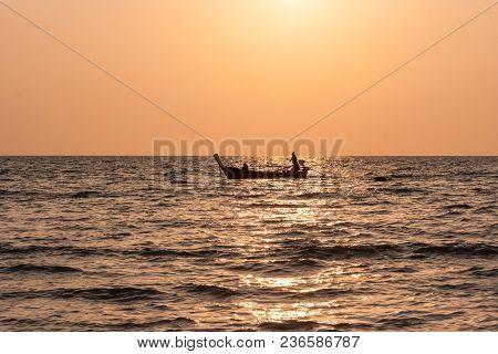 Traditional Thai Long Tail Boat At Sunset, Long Beach, Ko Lanta, Thailand.