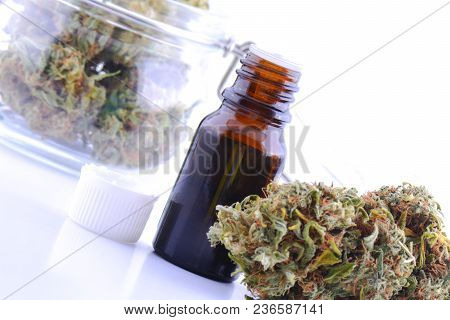 Medicinal Marijuana Cannabis With Extract Oil In A Bottle. Cannabis Cbd Oil Hemp Products. Cannabis