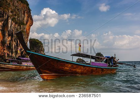 Traditional Thai Long Tail Boat At Sunset In Railay Beach, Krabi, Thailand.