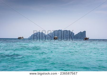 Phi Phi Leh, Seen From Tonsai Bay, In Koh Phi Phi Island, Thailand. Blue Sea Water And Boats.