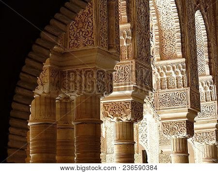 Carved Pillars And Archways Found In Palace In Granada, Spain.