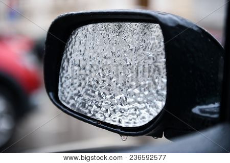 Vehicle Mirror Covered In Ice During Freezing Rain