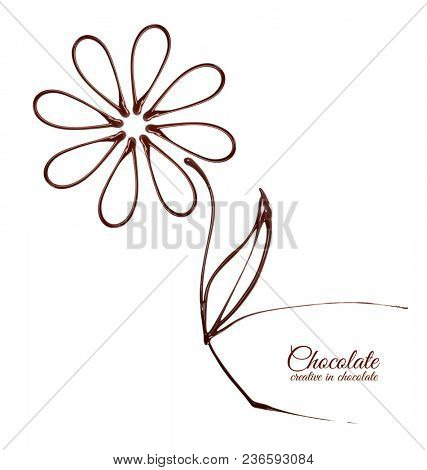 Chocolate in the form of a flower. Melted chocolate syrup on white background. Liquid chocolate on a white background.