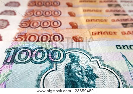 A Bill Of One Thousand Russian Rubles And Five Thousand Russian Rubles In The Background, Close-up