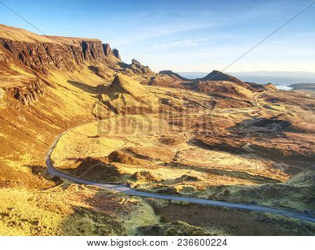 Empty Curvy Road In Scottish Highlands. Northwest Part Of Quiraing Hill,  On The Isle Of Skye In Sco
