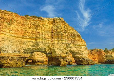 The Iconic Natural Arch Of Praia Da Marinha In Algarve, Portugal, Europe View From Popular Boat Cave