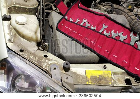 Set Wrenches In Organizer Unfolded Under The Hood Of The Car To Service The Engine. Arranged In The