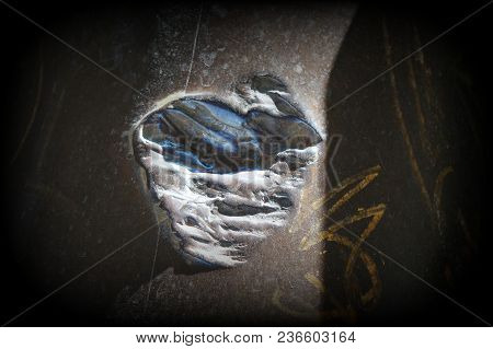 Fragment Of Cannon. Dark Background. Close-up Photo Of Metal Texture. Grunge Abstract Background On