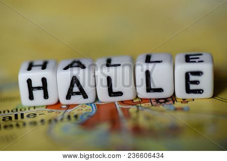 Word Halle Formed By Alphabet Blocks On Atlas Map Geography