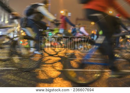 Abstract background of colored group of bicyclists on a city street. Parade of bicyclists, blur effect, unrecognizable faces. Sport, fitness and healthy lifestyle concept. poster