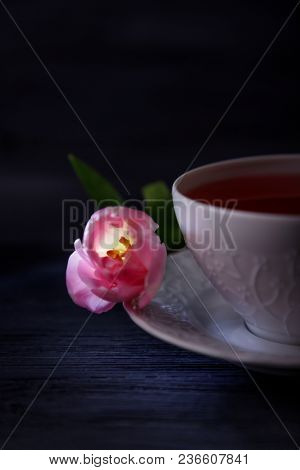 Fruit Tea In A White Cup And Pink Tulip. Low Key, Free Space
