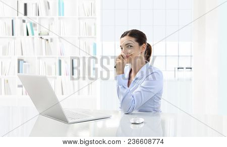 Business Smiling Woman Or A Clerk Working At Her Office Desk With Computer And Magnifying Glass, Sea