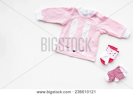 Newborn Baby's Background. Clothes For Small Girl With Booties On White Top View Copy Space