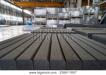 Close-up Of A Concrete Road Curbs At The Factory For The Production Of Cement Products, Paving Slabs