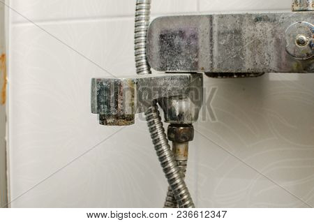 Hard Water Deposit And Rust On Shower Tap