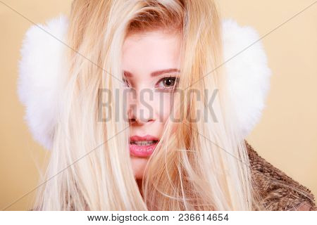 Accessories And Clothes For Cold Days, Fashion Concept. Blonde Woman In Winter Warm Earmuffs And Jac