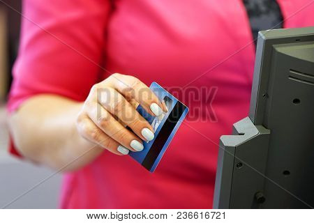 Credit Card Payment Terminal In Store. Seller Draws Up Credit Card Purchases. Close-up Of A Seller W