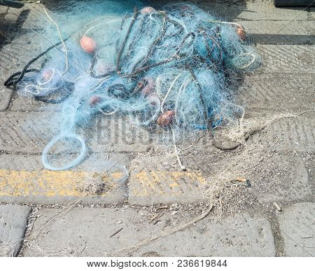 Fishing Net Laid Out On A Pier