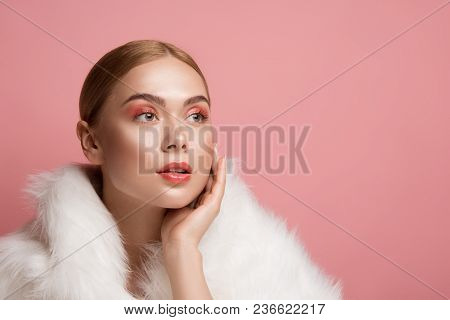 Portrait Of Good Looking Woman In Fur Coat. She Is Looking Aside With Serenity. Copy Space In Right