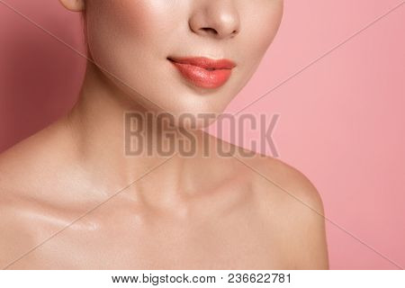 Naturalness And Femininity Concept. Close Up Of Woman Lips With Natural Gloss And Naked Shoulders. I