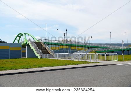 Facilitation Of Displacement For Pedestrians. Pedestrian And Disabled Footbridge Above The Highway.