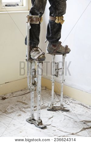 Plasterer On Stilts Plastering A High Ceiling