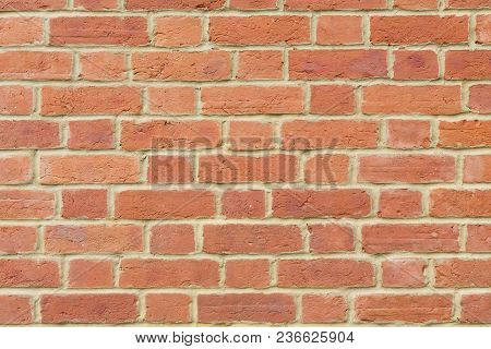 Red Brick Wall Background Closeup Pointed With Lime Mortar