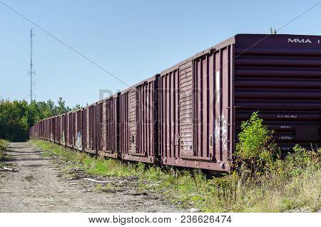 Millinocket, Maine, Usa - September 27, 2011: Long Line Of Boxcars On Siding Near Millinocket, Maine
