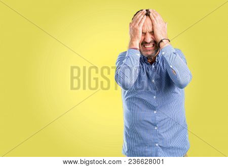 Handsome middle age man terrified and nervous expressing anxiety and panic gesture, overwhelmed
