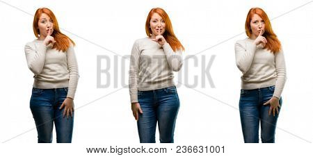 Young Beautiful redhead woman with index finger on lips, ask to be quiet. Silence and secret concept