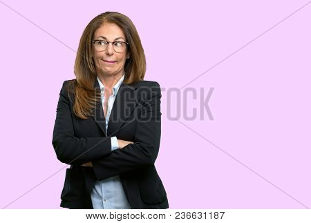 Middle age business woman nervous and scared biting lips looking camera with impatient expression, pensive