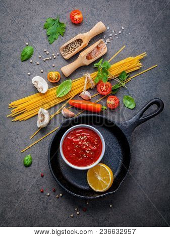 Italian Food And Menu Concept. Spaghetti With Ingredients Sweet Basil ,tomato ,garlic Peppercorn And