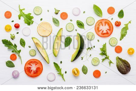 Food Pattern With Raw Ingredients Of Salad. Various Vegetables Lettuce Leaves, Cucumbers, Tomatoes,