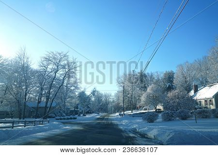 Residential Area And Street After Snow Storm With Sunny Sky