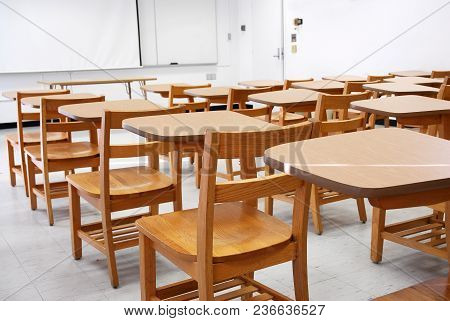 Classroom With Armed Chairs In University For Design