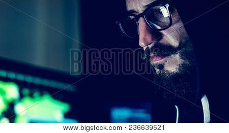 Closeup of hacker working on computer